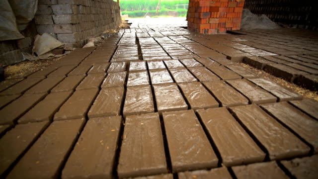 handmade bricks made by manual workers java indonesia - mud stock videos & royalty-free footage
