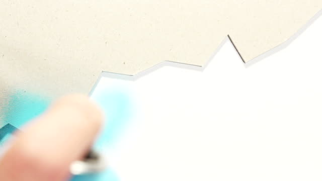 handmade chart stencil painting on the white wall - stencil stock videos & royalty-free footage