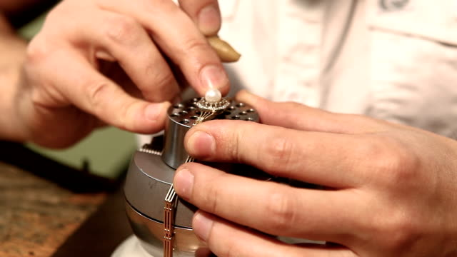 handmade ring with pearl. finishing touches at workshop - pearl stock videos and b-roll footage