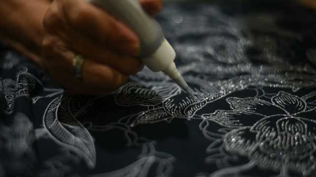 handmade textile ,painting the patterns for batik. - batik stock videos and b-roll footage