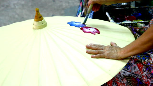 handmade thai style umbrella painting - drawing art product stock videos & royalty-free footage