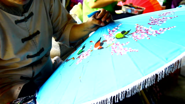 handmade thai style umbrella painting - stick plant part stock videos & royalty-free footage