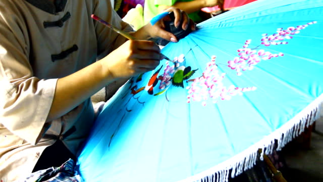 handmade thai style umbrella painting - drawing artistic product stock videos and b-roll footage