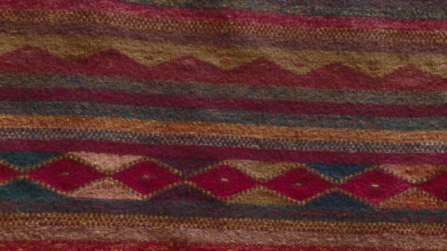 cu handmade traditional rug / oaxaca, mexico - ラグ点の映像素材/bロール