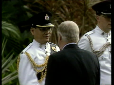 handover events chris patten wife mary lavender out of building past ceremonial guard standing to attention troops standing to attention outside... - 式典点の映像素材/bロール
