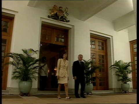 Handover events LTN ITN HONG KONG Governor's Residence Chris Patten wife Mary Lavender out of building past ceremonial guard standing to attention