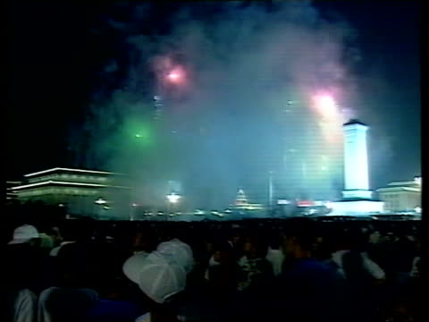 handover events; nat: itn-china tv pool china: beijing: tiananmen square: night: tgv crowds in square applauding people in square as fireworks... - pool hall stock videos & royalty-free footage