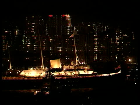 handover events nat itn hong kong victoria harbour night royal yacht britannia sailing along with litup skyscrapers in b/g convention centre gv... - tony blair stock-videos und b-roll-filmmaterial