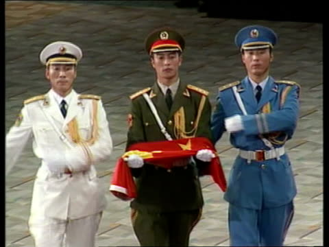 handover events three differently dressed chinese soldiers marching along as one carries a folded up chinese flag as joined by three differently... - folded stock videos and b-roll footage