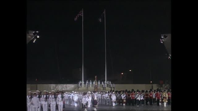 handover of hong kong: british sunset ceremony / prince charles speech; hong kong: wan chai: hms tamar military base: ext / night / raining... - hong kong stock videos & royalty-free footage