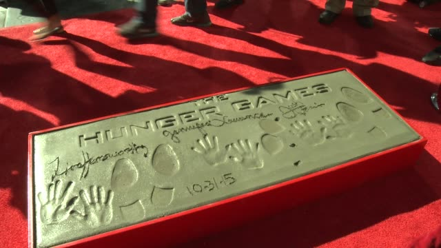 ATMOSPHERE handprints and footprints at Stars From Lionsgate's The Hunger Games Mockingjay Part 2 Hand And Footprint Ceremony at TCL Chinese Theatre...