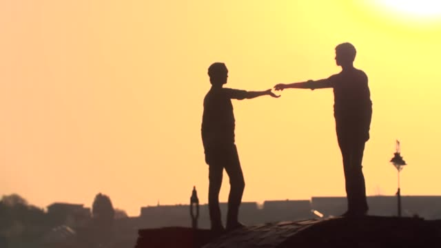 Hands Across the Divide statue at sunset in Derry filmed in connection with the murder of Lyra McKee
