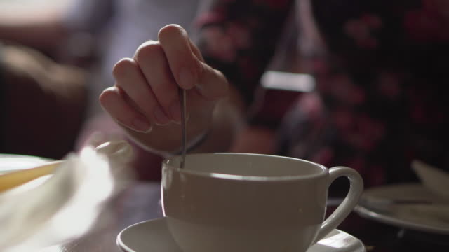 hands and coffee mug at table - heißes getränk stock-videos und b-roll-filmmaterial