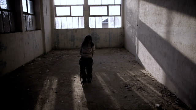 hands and legs of a victim woman tied up with rope in scary empty room - human trafficking stock videos & royalty-free footage