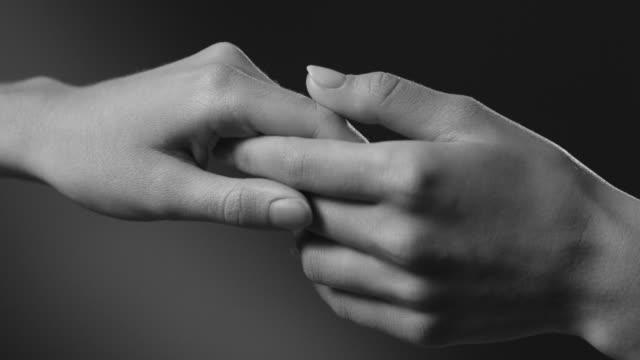 hands. arm movement. touch. - bianco e nero video stock e b–roll