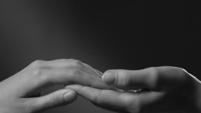 hands. arm movement.touch. - bianco e nero video stock e b–roll