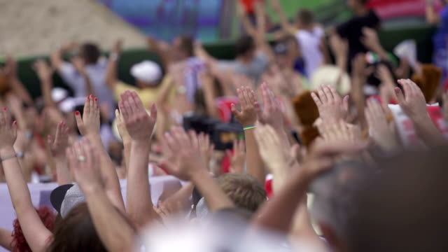 hands at sport competition audience - arms raised stock videos & royalty-free footage