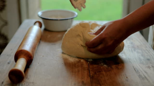 hands baking dough with rolling pin on wooden table - rolling pin stock videos & royalty-free footage