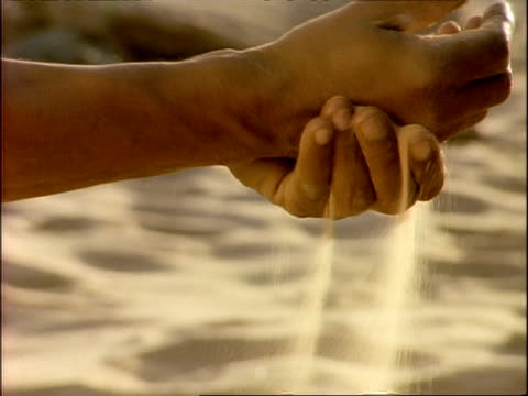 BCU hands being washed with sand, Algeria, Africa