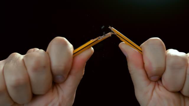 slo mo ld hands breaking a pencil in half - broken pencil stock videos & royalty-free footage