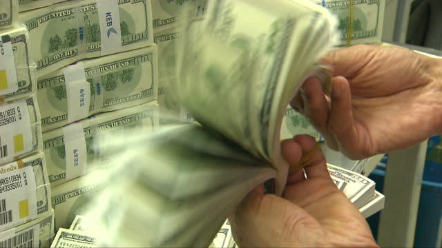 hands checking a bundle of 100 dollar bills - us dollar note stock videos & royalty-free footage
