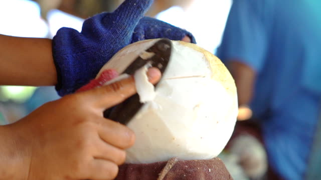 hands chopping coconut with a knife - coconut palm tree stock videos & royalty-free footage