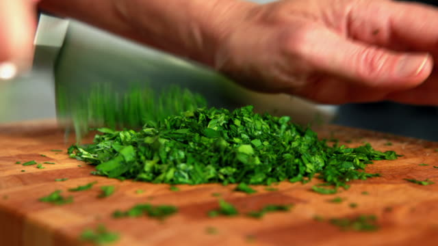 hands chopping parsley - parsley stock videos and b-roll footage