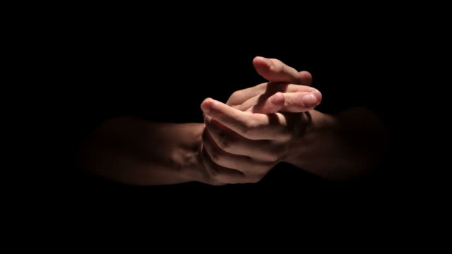 hands clapping on black background close up - applaudire video stock e b–roll