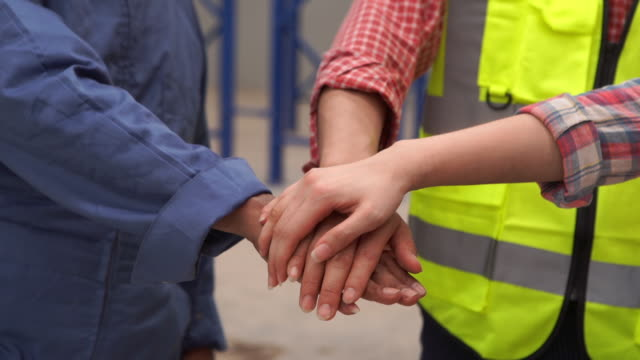 hands clasped for teamwork concept - unity stock videos & royalty-free footage