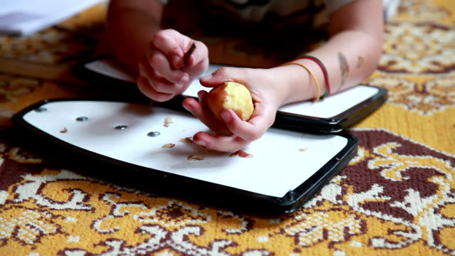 hands close-up of a child peeling potato with a wooden stick - adult imitation stock videos & royalty-free footage