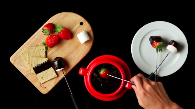 ms hands coating strawberry with melted chocolate / seoul, south korea - dipping stock videos & royalty-free footage