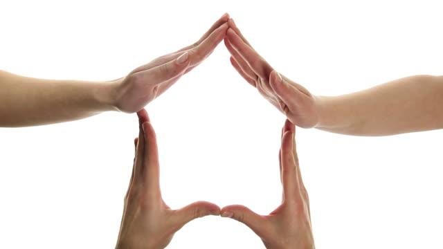 hands creating conceptual home symbol - conceptual symbol stock videos & royalty-free footage