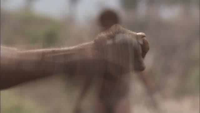 vídeos y material grabado en eventos de stock de hands crush rocks by pounding them together in kenya. - dañado