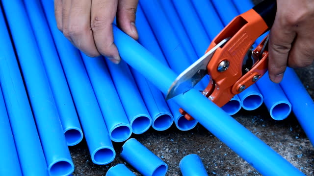 hands cutting pvc - pvc stock videos and b-roll footage