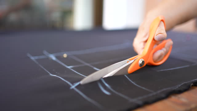 hands cutting suit fabric with scissors - suit stock videos & royalty-free footage
