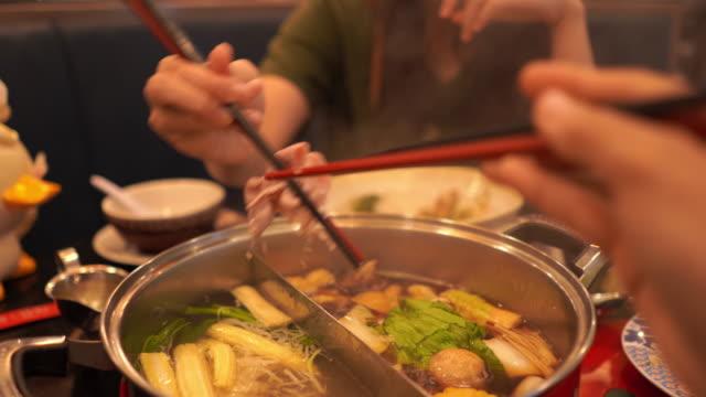 hand's eating food with chopsticks , sukiyaki , shabu-shabu - chopsticks stock videos & royalty-free footage