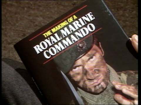 "hands flicking through pages of book 'the making of a royal marine commando' zoom in on cover of book itn cms nigel foster intvw sof ""when he left --... - book cover stock videos & royalty-free footage"