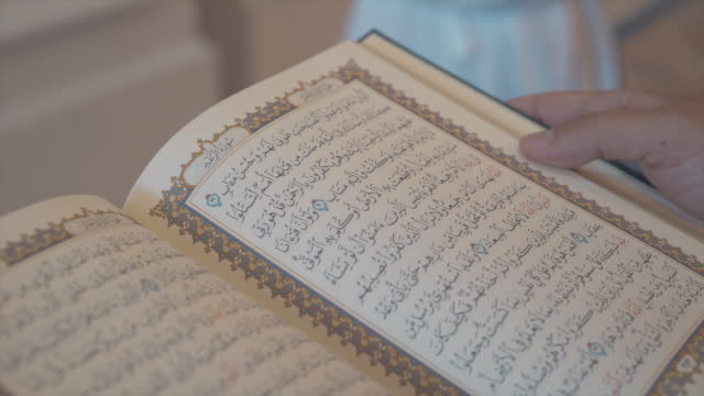 hands flipping pages of old arabic book - koran stock videos and b-roll footage