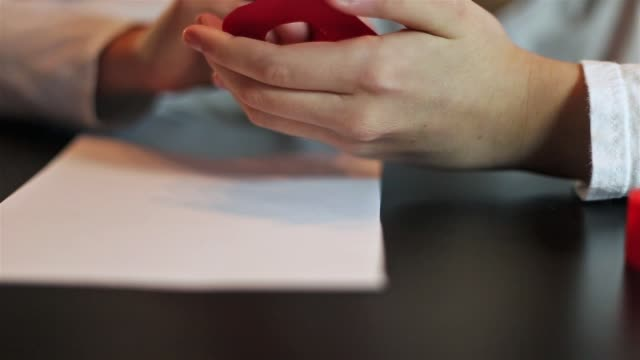 hands gluing a piece of paper and fixing it on a sheet. - parte de una serie video stock e b–roll
