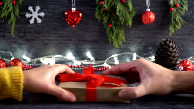 4k hands grabbing gift boxes on red flat lay - christmas present stock videos & royalty-free footage