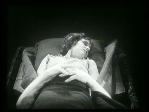 B/W hands grabbing woman in bed (Gertrude Olmstead)+ pulling her down into bed / woman yells