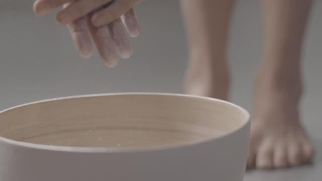 c/u slomo hands gymnast w/ magnesium - washtub stock videos and b-roll footage