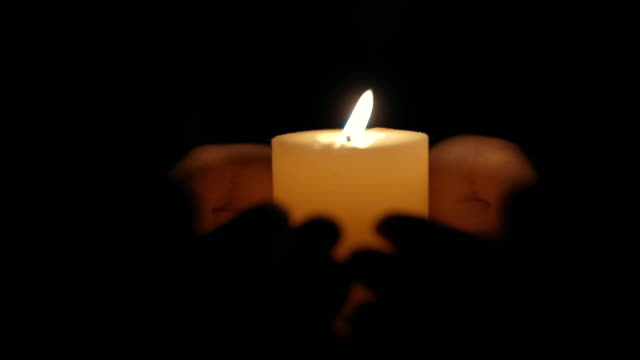 hands holding a burning candle - sensory perception stock videos & royalty-free footage