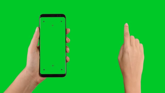 vídeos de stock e filmes b-roll de hands holding a smart phone and touching tapping sliding - chroma key
