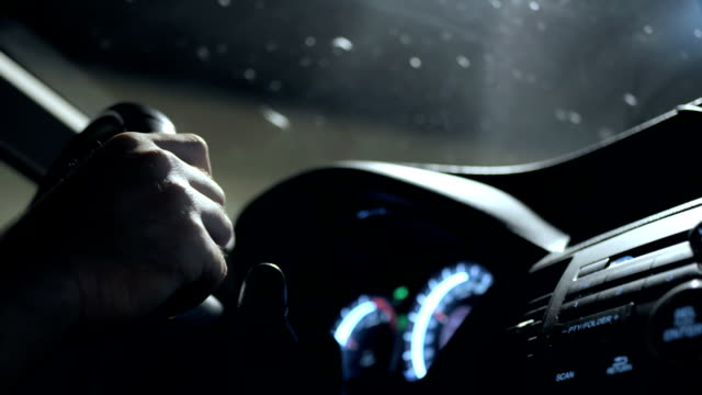 hd: hands holding a steering wheel - close up stock videos & royalty-free footage