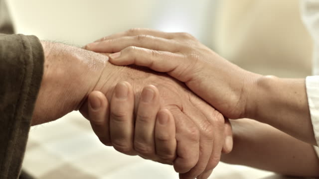 ds hands holding each other - healthcare worker stock videos & royalty-free footage