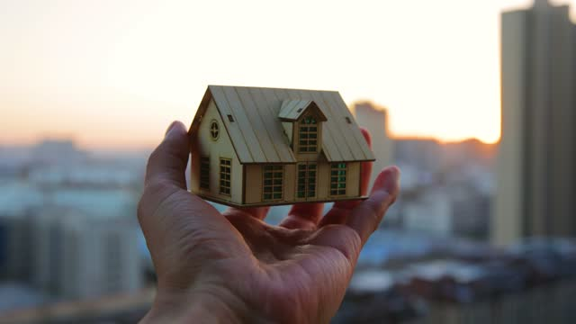 hands holding model house - small stock videos & royalty-free footage