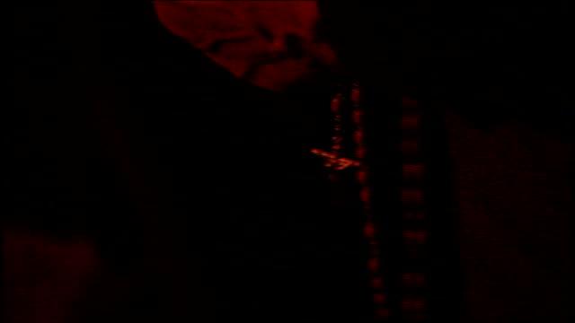 cu hands holding rosary beads in paterson nj - エディトリアル点の映像素材/bロール