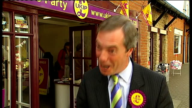 hands holding ukip leaflet nigel farage mep along with reporter ext nigel farage mep interview sot - on visiting 7 pubs in a day to meet local people... - nigel farage stock videos & royalty-free footage