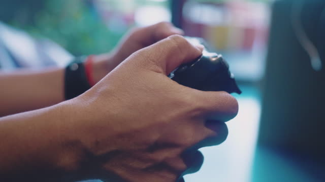 hands holding video game console controlling joystick - dependency stock videos & royalty-free footage